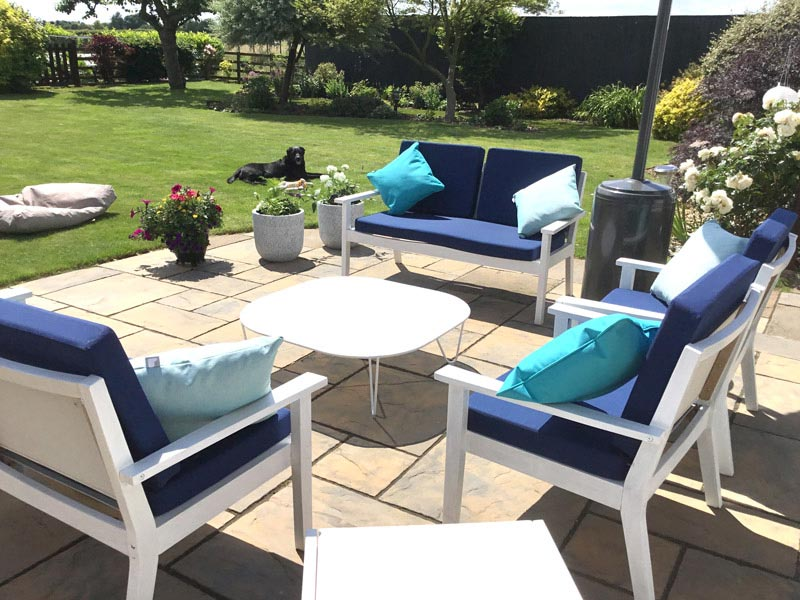 Bespoke outdoor seat and backrest cushions for a wooden garden chair set