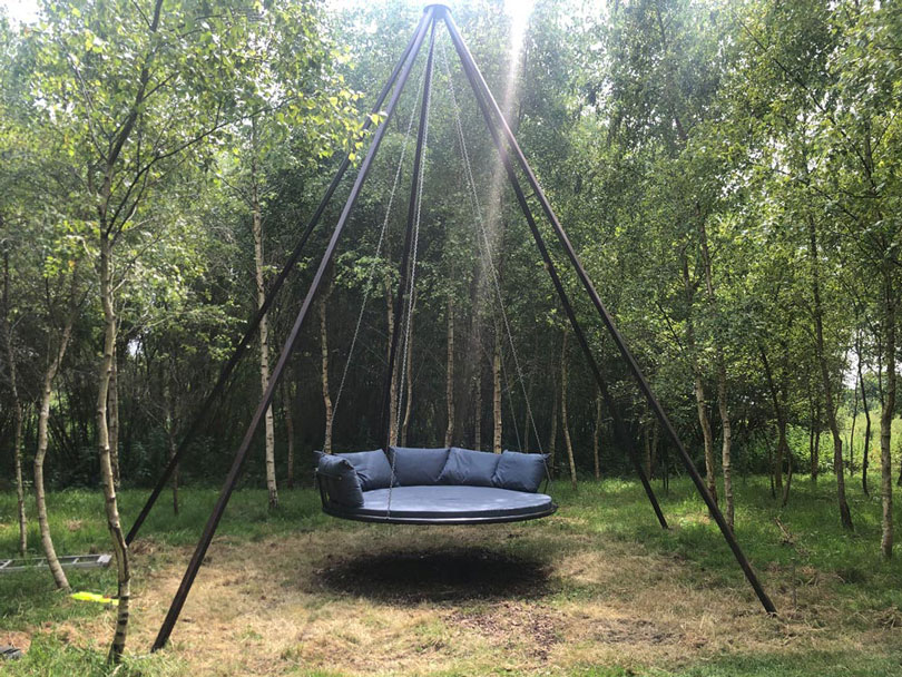 Outdoor seat and scatter cushions for a large circular swing bed