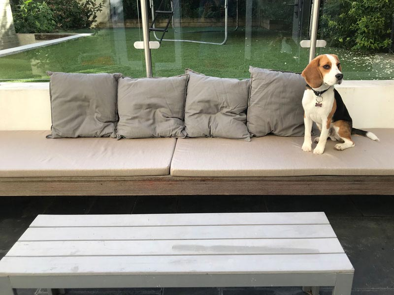 Bespoke coordinating outdoor seat and scatter cushions for a custom garden seating area