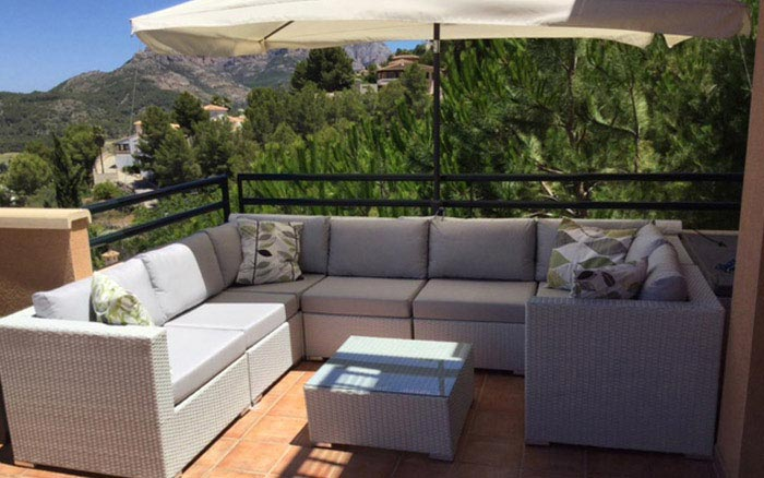Made-to-measure outdoor furniture cushions for a rattan balcony suite