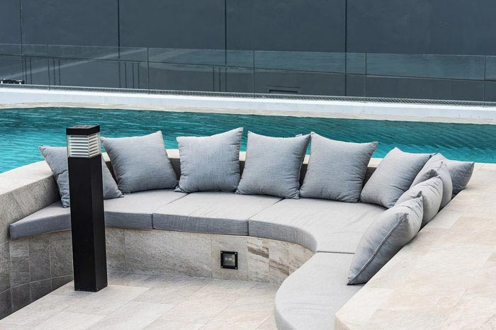 Specialist outdoor cushion fabric is cut to size and shape