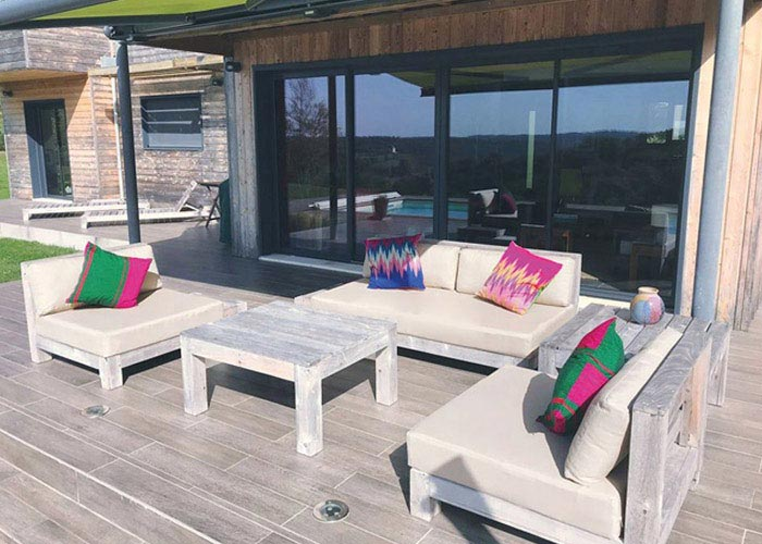 Bespoke outdoor cushions for a patio and poolside seating area