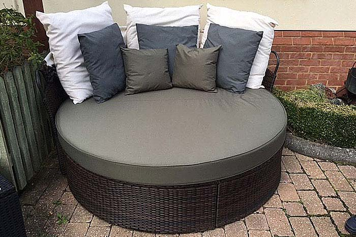 Bespoke outdoor seat and scatter cushions for a garden seating/bed feature