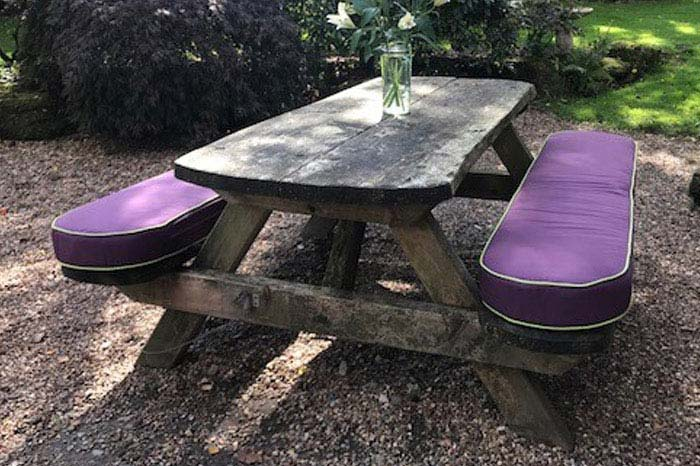 Bespoke outdoor cushions for a picnic bench