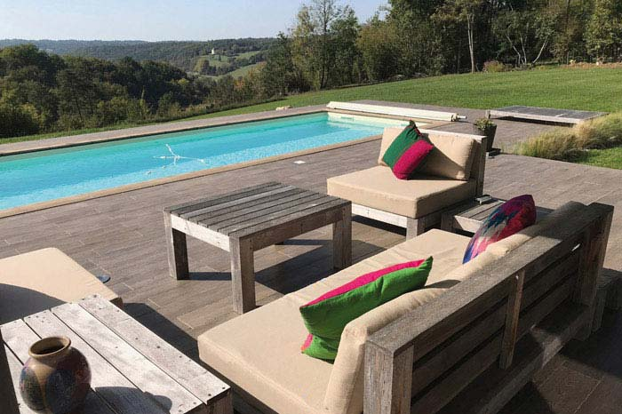 Bespoke outdoor waterproof seat cushions for a poolside seating area