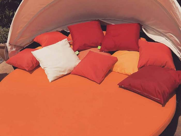 A set of new bespoke outdoor cushions for an oudoor circular bed/lounger